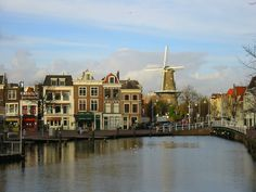 "A typical dutch photo :)  The city Leiden in the west of The Netherlands, in front the ""windmill the Valk"" Built in 1743, this is the only of the city's original 19 mills that still exists. It is a corn-grinding windmill and is now home to a museum."