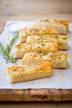 Freshly baked oil bread with onions and rosemary, drizzled with olive oil and sprinkled with salt flakes