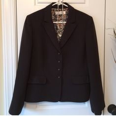"""Tahari Chocolate Blazer w/Fun Pattern Lining Gorgeous chocolate brown Tahari Arthur S. Levine Blazer. Fun colors & pattern on the lining, and beautiful small round metal buttons w/an intricate cutout design. EUC! Has been dry cleaned, looks absolutely flawless! Size 12. Approx meas: chest 21"""" laying flat, waist 18.5"""" flat, length 23.5"""". ✨Save on shipping cost & bundle!!✨ Tahari Jackets & Coats Blazers"""