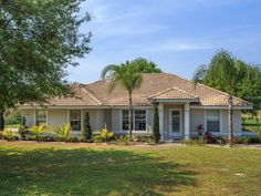 Property 12545 LAKE DENISE BLVD, Clermont, FL 34711 - MLS® #O5361889 - Purchase this bright, beautiful fully-furnished 3br/2ba tile-roof home with direct golf course frontage; it is move-in ready
