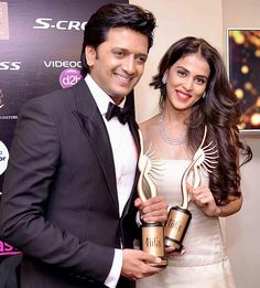 Riteish Deshmukh and wife Genelia D'Souza Deshmukh with their #IIFA Awards. #Bollywood #Fashion #Style #Beauty #Handsome