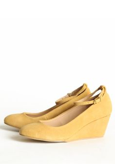 """Meriwether Ankle Strap Wedges By Marais 115.99 at shopruche.com. These low wedges in mustard effortlessly transition from work to evening. Finished with an adjustable ankle strap, rounded toe, and slightly padded sole.  All man-made materials, 2.25"""" heel height , Slightly padded footbed"""