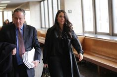 Judd Burstein walks with his client Andrea Tantaros, a former Fox News host, who is suing former network CEO Roger Ailes for sexual harassment, Wednesday in Manhattan Civil Supreme Court.