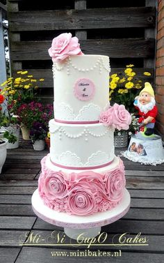 says it's a wedding cake but i think it looks more like a quinceanera or sweet 16 cake