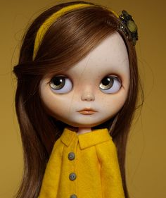 I sewed this yellow coat for her.