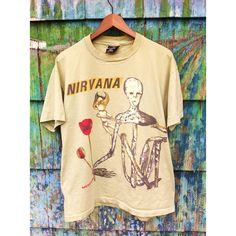 Rare Vintage 90's Original Nirvana Incesticide Tour Shirt Made in the... ($148) ❤ liked on Polyvore featuring tops, t-shirts, band tees, nirvana, fillers, vintage punk t shirts, cotton tee, checkered shirt, vintage t shirts and pixies t shirt