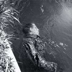 Dead SS guard.  Dachua, Germany.  1945.  Lee Miller.
