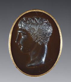 Ring with the Head of the Doryphoros of Polykleitos. Unknown carver; Unknown metalworker, Roman, 50 - 40 B.C.   The J. Paul Getty Trust
