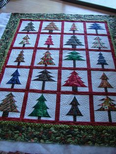 """this would be cute if you did different appliques in the squares, santa, sleigh, elf, reindeer, present, ornament, candy cane, gingerbread house, gingerbread man, """"dec 24"""""""