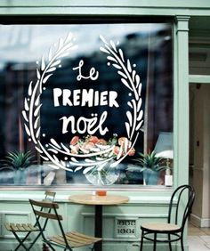 Outdoor window paint can be used to advertise sales and use seasonally. This image also gives a great vision for the cafe furniture upstairs