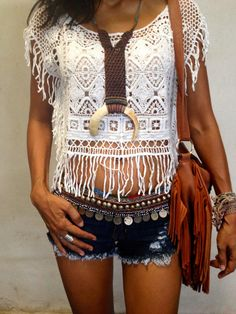 Sweet embroidered crochet crop top for a boho chic look with gypsy coin belt and modern hippie purse perfect for music festivals. For the best BOHEMIAN fashion style FOLLOW https://www.pinterest.com/happygolicky/the-best-boho-chic-fashion-bohemian-jewelry-gypsy-/ now.