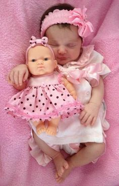my baby doll niece with her baby doll :)