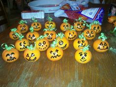 Clemantines/mandarine oranges turned into pumpkins for a healthy halloween school treat! All it takes is a little black puff paint and green curling ribbon!