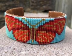 Beaded Red and Gold Butterfly Bracelet on a Matte Turquoise Background. Wonderful gift for any occas Loom Beading, Beading Patterns, Loom Patterns, Jewelry Patterns, Bead Loom Bracelets, Bracelet Crafts, Silver Bracelets, Bangles, Turquoise Background