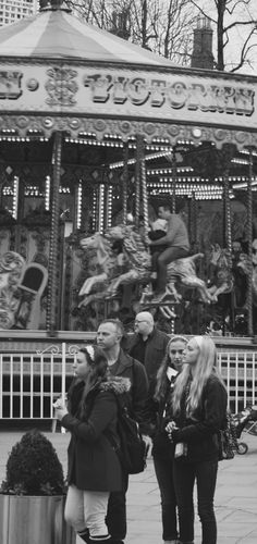 Kilkenny - Ireland Love the mood in this pic. Dad on the Carousel concerned about his child. Or just plain having fun! Pedestrians in the foreground concerned about crossing the road.