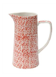 This charming serving vessel has a hand stamped chintz design of red flowers on white glazed stoneware.