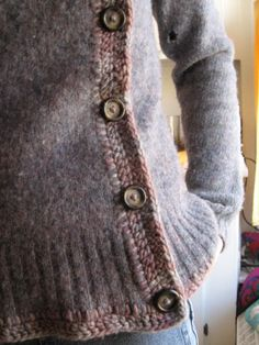 "upcycled men's pullover. amazing. ""wash and dry at high heat to shrink and felt it up, slice down the front to make it a cardigan, then blanket stitch the border, crochet the overlap, add buttons."" !!!!!"