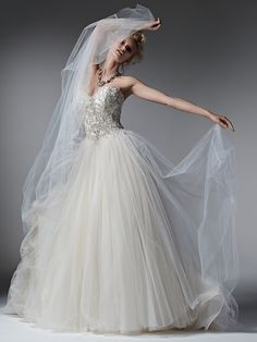Sottero and Midgley - LAYLA, Whimsical layers of tulle create the skirt of this romantic ball gown wedding dress, while sparkling Swarovski crystals, pearls and beads adorn the bodice. Finished with sweetheart neckline and corset closure.