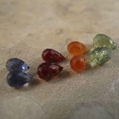 Fall Colors Briolette Mix Bag - 8 stones - Spessartite, Iolite, Peridot, and Garnet - (L-Mix1). $13.00, via Etsy.