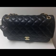 Chanel Lambskin Leather material. Black with gold hardware. Comes with the dust bag and Chanel box. Top notch quality. It is not auth at this price CHANEL Bags