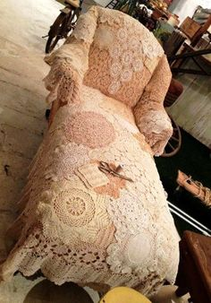 A beautiful caise lounge covered in lace, I wil ni\ot sit on this one  LOL