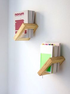Book shelves do not have to be bulky. A simply shelf like shown in the image is a creative way of keeping your books or files. It is simple and tidy!