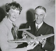 Amelia Earhart and a model of her Lockheed Electra 10e.
