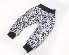 Black and White Leopard Print Baggy Harem Pants by SunnuBunnu Cuffed Pants, Harem Pants, White Leopard, Newborns, Black Pants, Infant, Sweatpants, Black And White, Trending Outfits