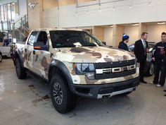 Ford F-150 Raptor vinyl wrapped in Camo. Perfect Hunting Truck