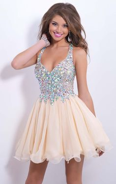 Make a lasting impression in Blush by Alexia 9857. This lovely cocktail dress features a fitted bodice with a v neckline, thick straps and a sheer back. Crystals and jewels adorn the bodice and back.