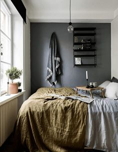 Ways to Make a Small Space Feel Bigger: Paint One Wall Dark | Apartment Therapy