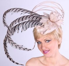 Stand out in the Derby Crowd in this Beige Feather Fascinator from HAT-A-TUDE