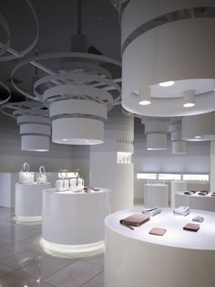 Patrick Cox shop in Tokyo, Japan Custom luminaires and ceiling-hung sculptures - stretch ceiling membrane in flat or glossy finishes, white, black or colour, or printed with a photo or graphic.