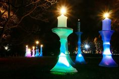 Giant Christmas candles are just one of many light installations along the mile long illuminated trail at Christmas at Kew 2016 at the Royal Botanic Gardens, Kew.