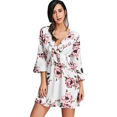 Style: Brief :    Material: Polyester/Spandex :    Silhouette: A-Line :    Dresses Length: Mini :    Neckline: Plunging Neck :    Sleeve Type: Flare Sleeve :    Sleeve Length: 3/4 Length Sleeves :    Pattern Type: Floral :    With Belt: No :    Season: Fall/Spring :    Weight: 0.287 kg :    Package Contents: 1 x Dress: