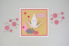Réalisez un faire-part original en vous initiant à l'origami pour annoncer la naissance de votre enfant.
