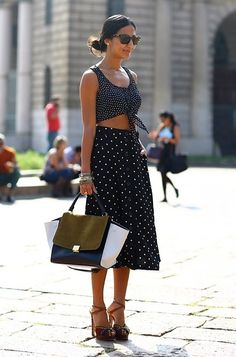 This outfit could actually tempt me to wear 2 things I never would: mid-calf skirts and crop tops How To Wear A Crop Top | StyleCaster