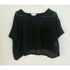 Black Sheer cropped top Black cropped top. Semi sheer. Given to me as a free gift from a purchase I made, but unfortunatly doesn't fit! I believe it is from a UK Brand but it is a US size medium. Small pocket in the front. Sabo Skirt Tops