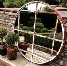Circular architectural garden mirror with great inner panel design