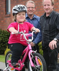 Photo of the Week: New Zealand Lions Donate a Special Bike to a Special Girl