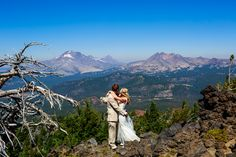 Cute wedding photo on Mt Bachelor after the first look. Enjoying the view of the mountain that he proposed on the summit of from Mt Bachelor, Oregon.  http://www.joshuameador.com/weddings/mt-bachelor-wedding
