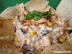 Fiesta Dip: cream cheese, sour cream, sweet corn, black beans, rotel taco seasoning, shredded cheese