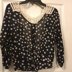 "Charlotte Russe polka dot medium blouse New without tags's buttons up the front ties on the bottom 100% polyester, measures 42"" bust...18"" sleeve...20"" length Charlotte Russe Tops Blouses"