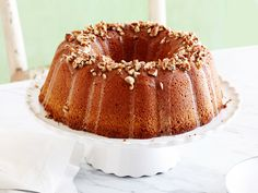 Damaris' Bourbon Pecan Cake : In true Kentucky-native form, Damaris lets bourbon shine in her party-ready pecan cake. This striking beauty is laced with cinnamon for subtle warmth, and a mixture of butter and milk guarantees moist results. Just Desserts, Delicious Desserts, Dessert Recipes, Cupcake Recipes, Drink Recipes, Southern At Heart Recipes, Pecan Cake, Caramel Pecan, Pound Cake Recipes