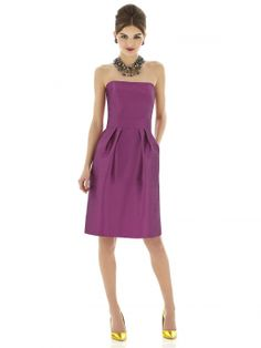 Cocktail length strapless dupioni dress w/ shaped inset midriff and pleated skirt. Pockets at side seams of skirt. Flat bow detail at center back. Also available full length as style D615.