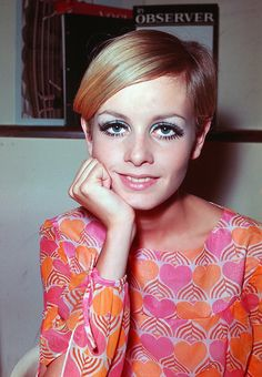 Twiggy, 1960's model, with a pixie haircut and a darling pink & orange dress.