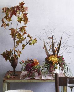 Branches, berries, feathers and flowers: Thanksgiving table centerpiece inspiration.