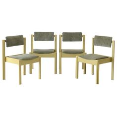 A set of four award-winning Clive Bacon Jigsaw interlocking chairs from the These four wooden chairs featured pegged joinery and are finished with olive green upholstery to the back and seat. Mid Century Modern Furniture, Joinery, Mid-century Modern, 1960s, Bacon, Dining Chairs, Upholstery, Table, Home Decor
