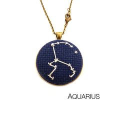Aquarius Zodiac Constellation Cross Stitch Necklace from Zelma Rose for $75.00