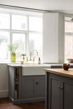 A beautifully simple sink area with deVOL's aged brass taps and a big Belfast sink